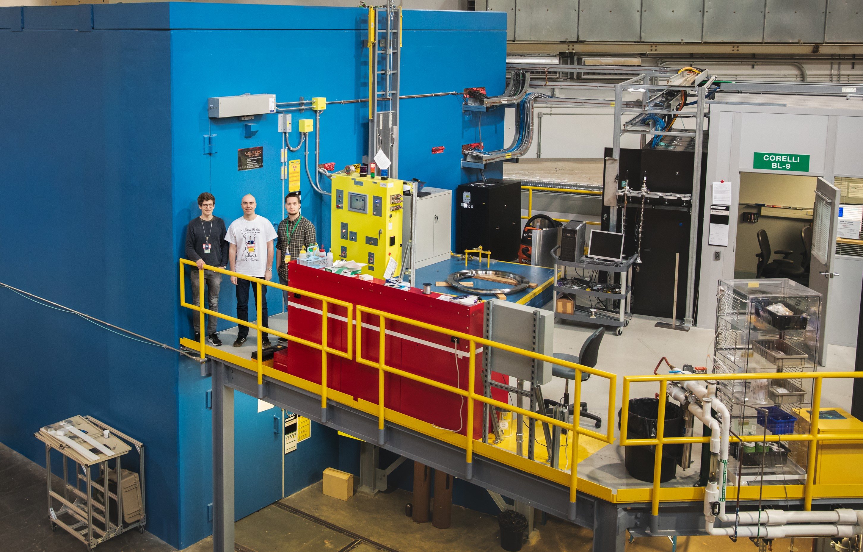 The research team, (left) Kristoffer Holm, Nikolaj Roth, and Emil Klahn, stands next to the CORELLI neutron scattering instrument at ORNL's Spallation Neutron Source. (Credit: ORNL/Genevieve Martin)