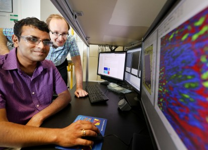 ORNL's Sergei Kalinin and Rama Vasudevan (foreground) use scanning probe microscopy to study bulk fe