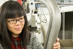 Lu Huang, USS industrial research engineer prepares a lightweighted advanced high strength steel component for neutron research at the Spallation Neutron Source's VULCAN instrument. Data from this study may make it faster and easier for companies to design automotive components that are lighter, more durable, and safer. Image Credit: ORNL/Genevieve Martin