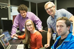 Shown here are Emil Bozin (standing, left) from Brookhaven National Laboratory, Sandra Skjærvø and Sverre Magnus Selbach (both seated) from the Norwegian University of Science and Technology, and Simon Billinge of Columbia Univ. and Brookhaven (standing, right) reviewing real time data at the NOMAD instrument hutch, SNS beam line 1B. Image credit: Genevieve Martin/ORNL
