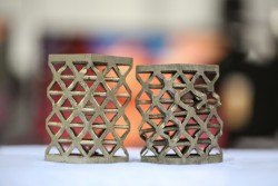 Energy absorbing cast aluminum lattice samples, before deformation (left) and after deformation (right), were examined at HFIR's polychromatic cold neutron beamline (CG-1D) for structural quality and behavior under loads. (Image credit: ORNL/Genevieve Martin)