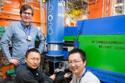 Georgia Tech's Martin Mourigal (left) and Xiaojian Bai (right), along with Florida State University's Lianyang Dong (center), explore low-temperature quantum states in the mineral Cu-Elpasolite at HFIR beam line HB-2A. (Image credit: ORNL/Genevieve Martin)v