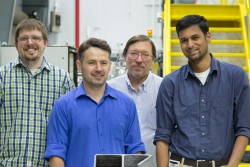 Researchers from the DOE Manufacturing Demonstration Facility located at ORNL used neutrons to test residual stress in 3D-printed steel parts. By studying complex geometries like the figure 6 shown here, researchers can design and build more complex structures with large-scale 3D metal printing. Pictured from left, Jeffrey Bunn, Andrzej Nycz, Mark Noakes, and Niyanth Sridharan. (Credit: ORNL/Genevieve Martin)
