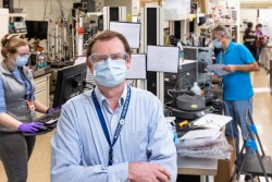 Hugh O'Neill, director of ORNL's Center for Structural and Molecular Biology, is leading a team of scientists in an ambitious research campaign to provide structural information at the atomic scale on SARS-CoV-2. He and his team are using neutron scattering at two of DOE's flagship research facilities to aid in the development of treatments to stop the deadly virus. (Left) Gwyndalyn Phillips, Hugh O'Neill, Kevin Weiss, Swati Pant, and Qiu Zhang. (credit: ORNL/Carlos Jones)