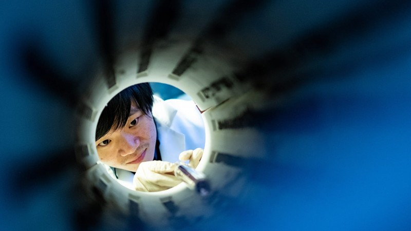 """Rice University graduate student Lebing Chen spent three months perfecting a recipe for making flat sheets of chromium triiodide, a two-dimensional quantum material that appears to be a """"magnetic topological insulator."""" (Photo by Jeff Fitlow/Rice University)"""