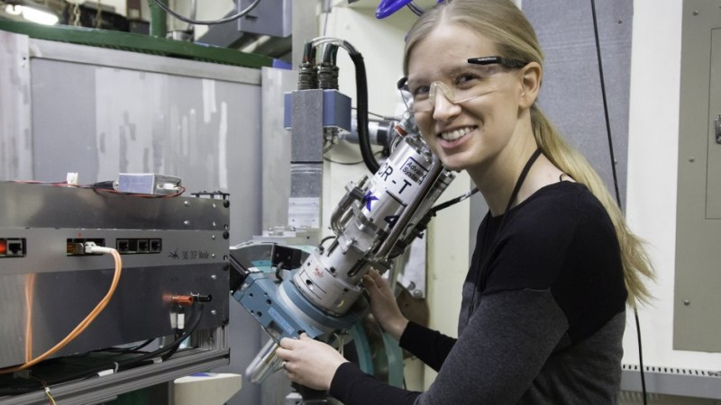 Paige Kelley uses the Four-Circle Diffractometer at HFIR to study ruthenium trichloride, obtaining its ordered moment size with the instrument's unique capabilities. Kelley's research could help lead to the realization of the qubit. Where bits represent either a 1 or 0 in conventional computing, qubits can achieve a mixed state called a superposition in which they are both 1 and 0 at the same time. This ability is critical to powering quantum computing. (Image credit: Genevieve Martin)