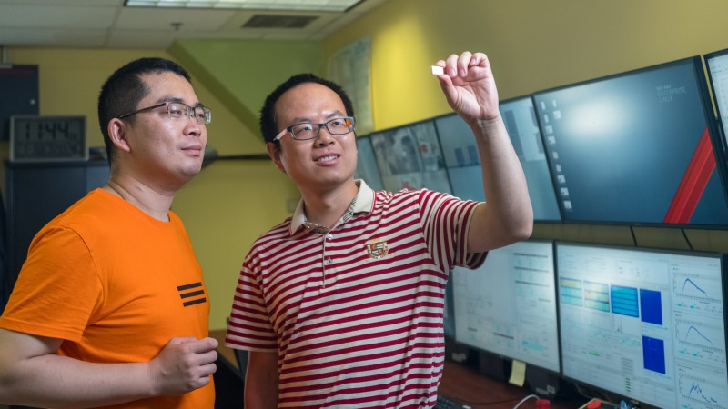 University of Nebraska-Lincoln researchers Xiang Zhang (left) and Prof. Bai Cui use neutron diffraction to study the microstructure and residual stress characterizations of additively manufactured ceramic materials. (Credit: ORNL/Carlos Jones)