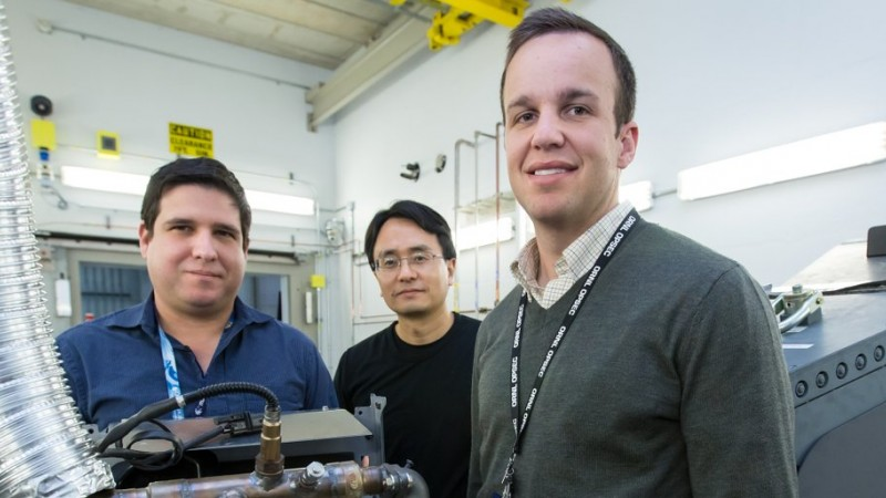 Researchers used neutrons to probe a running engine at ORNL's Spallation Neutron Source, giving them the opportunity to test an aluminum-cerium alloy under operating conditions. From left, researchers Orlando Rios, Ke An, and Lt. Eric Stromme show off a cylinder head made from the new alloy. (Image credit: ORNL/Genevieve Martin)
