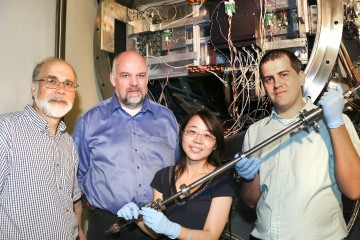 Pictured at the NOMAD instrument at ORNL's Spallation Neutron Source are David Wesolowski of the Chemical Sciences Division, Thomas Proffen of SNS, Hsiu-Wen Wang of JINS, and NOMAD instrument scientist Mikhail Feygenson.