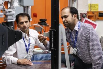 Timken researchers Vikram Bedekar (left) and Rohit Voothaluru