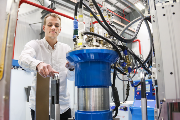 Tyson Lanigan-Atkins, a PhD student at Duke University, uses the cold (lower-energy) neutron triple-axis spectrometer at ORNL's High Flux Isotope Reactor to study thermoelectric materials. Image Credit: ORNL/Genevieve Martin