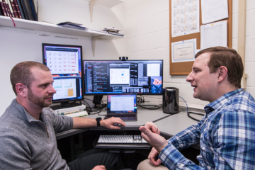 Marc Janoschek, left, and David Fobes discuss features of quantum materials. (Image Credit: Los Alamos National Laboratory)